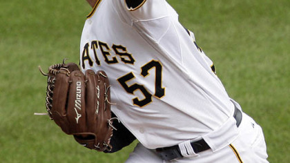Pirates pitcher Zach Duke throws in the ninth inning.