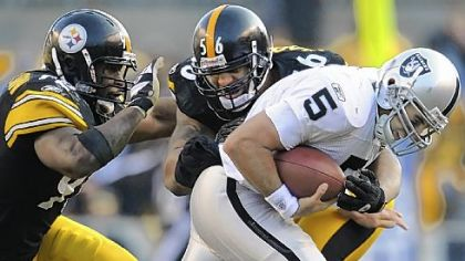 LaMarr Woodley sacks Raiders quarterback Bruce Gradkowski with help from James Harrison on Sunday. Statistically, the Steelers have a top 5 defense but a 6-6 record.