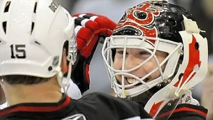 Devils goalie Martin Brodeur is all smiles after shutting out the Penguins and breaking the record for career shutouts with 104.