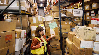 Kathleen Hower, Executive Director of Global Links, is dwarfed by a shipment being assembled for Guatemala in the organization''s warehouse in Pittsburgh''s Homewood neighborhood.