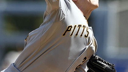 Pirates starting pitcher Kevin Hart delivers against the Dodgers during the first inning of yesterday&#039;s game in Los Angeles.
