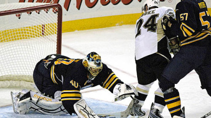 Patrick Lalime, on in relief of Ryan Miller, reaches to cover a loose puck as Sabres defenseman Tyler Myers checks Matt Cooke during the third period.