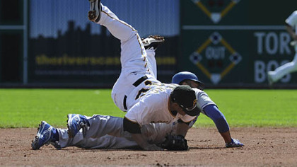 Pirates shortstop Delwyn Young completes a double play as he collides with Dodgers outfielder Matt Kemp at second base.