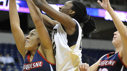 Duquesne player Samantha Pollino (30) battles for a rebound against Pitt&#039;s Chelsea Cole (22).