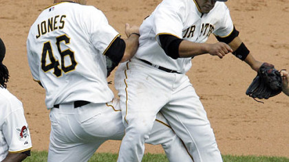 Pirates first baseman/outfielder Garrett Jones and second baseman Delwyn Young celebrate yesterday's win.