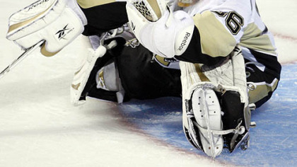 Penguins goaltender John Curry makes a glove save against the Canadiens during second period of las night&#039;s 4-3 loss in Montreal.