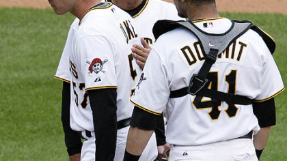 Pirates pitcher Zach Duke, left, is pulled from the game in the ninth inning with two outs, and with a 10-run lead by manager John Russell, center, as catcher Ryan Doumit watches during yesterday's 11-1 win at PNC Park.