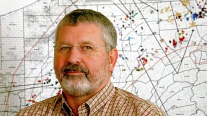 Ray N. Walker Jr., vice president of the Marcellus Shale division at Range Resources in Canonsburg, with a map of the active natural gas wells in Pennsylvania.