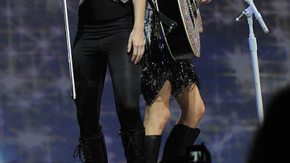 Taylor Swift shares the stage with the band&#039;s back-up singer.