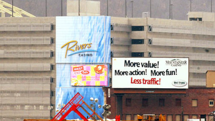 The Mountaineer Gaming Resort has a billboard in front of the Rivers Casino on the North Shore.