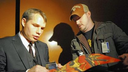 "Shepard Fairey autographs his book on Oct. 17 after speaking to sold-out crowed before the opening of his show ""Shepard Fairey: Supply and Demand"" at The Andy Warhol."