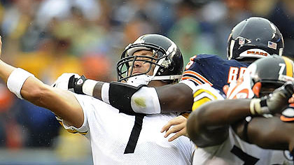 The Bears' Alex Brown pressures Ben Roethlisberger yesterday.