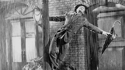 "The iconic photo of Gene Kelly in the 1952 film ""Singin' in the Rain."""