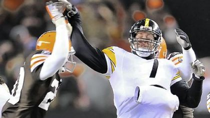Steelers quarterback Ben Roethlisberger is hit by Browns safety Mike Adams in the fourth quarter of last night's game at Cleveland Browns Stadium.