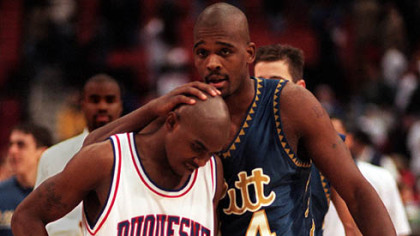 Pitt forward Gerald Jordan talks to Duquesne guard Mike James following the 1996 City Game at the Civic Arena. Pitt won, 75-73.