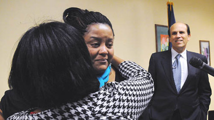Jamilla Rice tears up as  her mother, Dr. Aisha White, embraces her. Michael Milken is at right.
