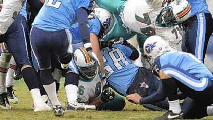 Tennessee Titans place kicker Rob Bironas makes a 46-yard field-goal attempt in overtime to beat the Miami Dolphins, 27-24, yesterday. 