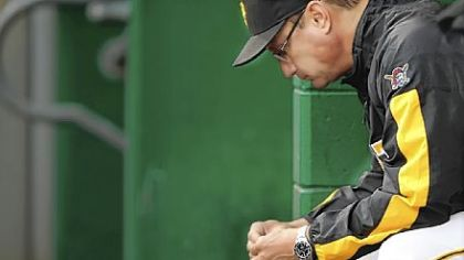 Pirates management wants manager John Russell to return next season.