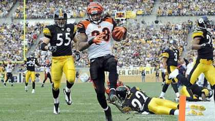 Bengals' Bernard Scott crosses the endzone as he returns a kickoff for a touchdown early in today's game.