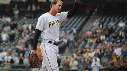 Pirates pitcher Zach Duke raises his hat for cheering fans as he leaves the game.