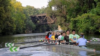 The Taylor Allerdice novice teams paddles along a channel of the Allegheny River during a Septemner practice in anticipation of the Head to the Ohio Festival.