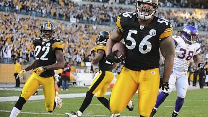 Steelers linebacker LaMarr Woodley picks up a loose ball and returns it for touchdown against the Minnesota Vikings.