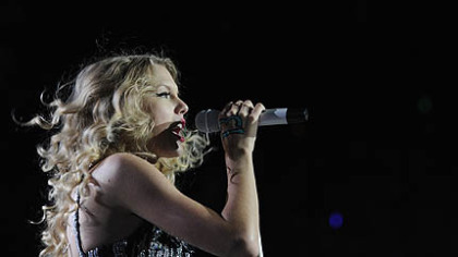 Taylor Swift belts out a song.