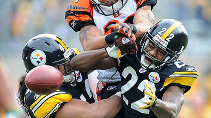 Steelers defensive backs Troy Polamalu and William Gay break up a pass intended for Bengals wide receiver Laveranues Coles.