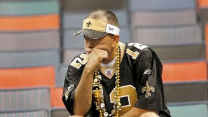 A New Orleans Saints fan mulls over his team's 24-17 loss to the Dallas Cowboys Saturday night. The Saints fell behind early, allowing touchdowns on the Cowboys' first two possessions, and couldn't recover from first-half mishaps.