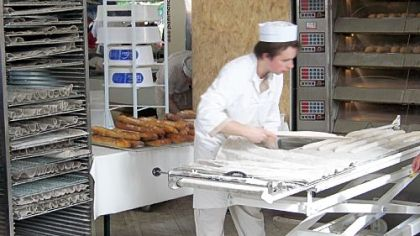 A baker makes baguettes at la Fete du Pain, the annual Festival of Bread in Paris.