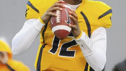Geno Smith came on for the injured quarterback Jarrett Brown and helped lead the Mountaineers to a 24-7 victory against in-state rival Marshall.
