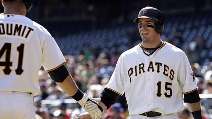 Pirates third baseman Andy LaRoche is greeted by teammate Ryan Doumit after scoring on a single by Pirates first baseman/outfielder Garrett Jones in the second inning.