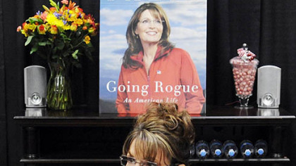 Former Vice Presidential nominee Sarah Palin signs copies of her book yesterday at Sam&#039;s Club in South Strabane.