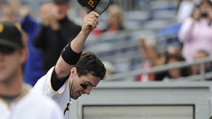 Pirates third baseman Andy LaRoche raises his helmet after a two-run home run in the bottom of the eighth inning.