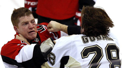 Senators forward Chris Neil fights with Penguins forward Eric Goddard during the third period.