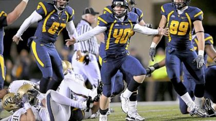 West Virginia&#039;s Tyler Bitancurt celebrates after kicking the winning field goal against Pitt as time expired last night at Mountaineer Field in Morgantown, W.Va.