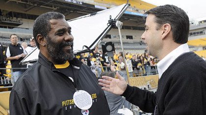 Former Steeler Joe Greene chats with Tommy Okon, who was featured in a commerical 30 years ago. They meet prior to the Sunday's game at Heinz Field.