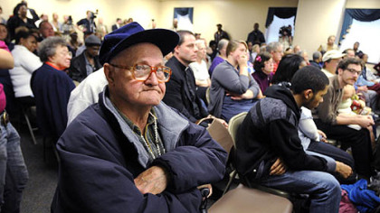 Charles Lytle, 79, of East Pittsburgh, who has been treated at UPMC Braddock, listens after asking a question concerning the hospital's planned closing during a community meeting last night.