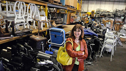 "Kathleen Hower, executive director of Global Links, is surrounded by recent donations of medical equipment crowding the organization's warehouse in Homewood. ""It's a nice problem to have,"" she said."