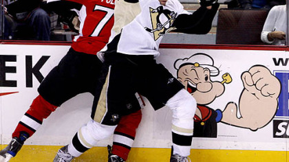 Senators forward Nick Foligno is checked by Penguins forward Michael Rupp during the second period.