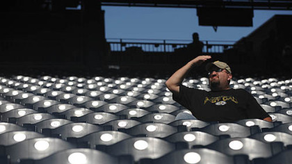 Shawn Gray of Canonsburg covers his eyes from the sun as he watches the Pirates beat the Dodgers, 11-1.