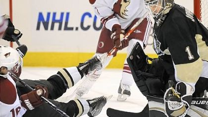 Penguins goalie Brent Johnson makes save on Phoenix&#039;s Petr Prucha in a game earlier this month.