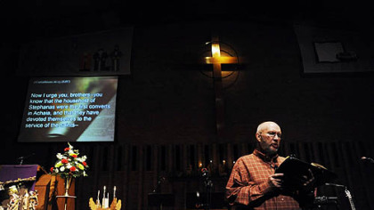 "The Rev. Bob Titus reads scripture as it is projected onto a screen for all the church to see during a ""contemporary"" service held at the Lebanon Presbyterian Church on Dec. 6."
