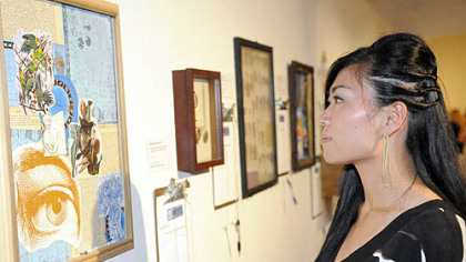Yuko Asano looks at the art.