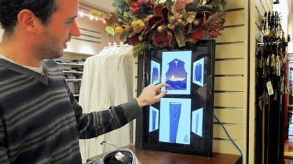 Carnegie Mellon student Philip Croul demonstrates how to use a Smart.Mirror to help coordinate clothing in the Charles Spiegel for Men store in Squirrel Hill.