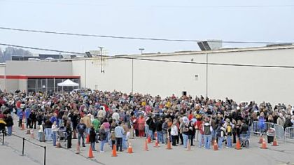 More than 1,000 people wait in line to see former Alaska Gov. Sarah Palin yesterday.