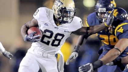 Pitt&#039;s Dion Lewis looks for running room against WVU in the first quarter. Lewis finished with 26 carries for 155 yards.