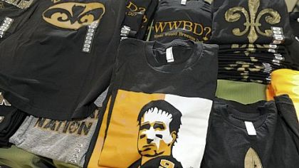 "A T-shirt shop on Magazine Street in New Orleans is finding it dificult to keep Saints-themed shirts such as ""Datman"" and ""What Would Breesus Do'' on its shelves."