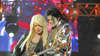 "Michael Jackson and Orianthi tear up the screen in ""This Is It."""