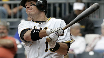 Pirates third baseman Andy LaRoche follows through on a two-run home run off Dodgers pitcher James McDonald during the eighth inning.